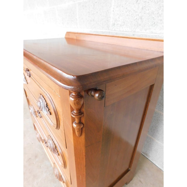 Features Quality Walnut Primary with Mahogany Top, 3 Drawers, with Acorn/Leaf Drawer Pulls, and Pull Out Right Side Towel...