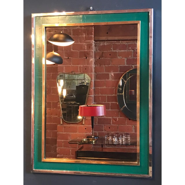 Mid-century Tommaso Barbi green mirror in chrome and brass, Italy, 1970s Rectangular mirror in double frame: the external...