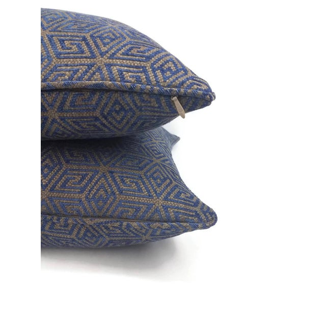 From F. Schumacher is Cosmati Chenille in the color Ultramarine. This pillow is finished with a self-welt edge to give it...