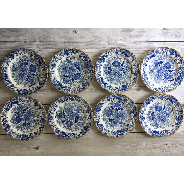 Gorgeous set of 8 vintage blue & white chintz dessert plates with a beautiful 22k gold trim. These pretty plates look...