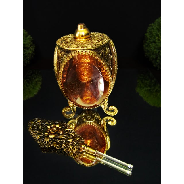 French gold gilt perfume bottle encased in 24 KT gold plated Ormolu filigree. Casket style bottle with amber/ topaz...