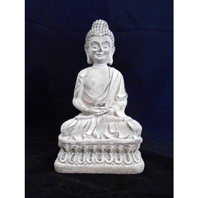 Sitting Buddha statue. Made of cement. Has felt pads under the base to prevent scratching table tops. Great for indoor or...