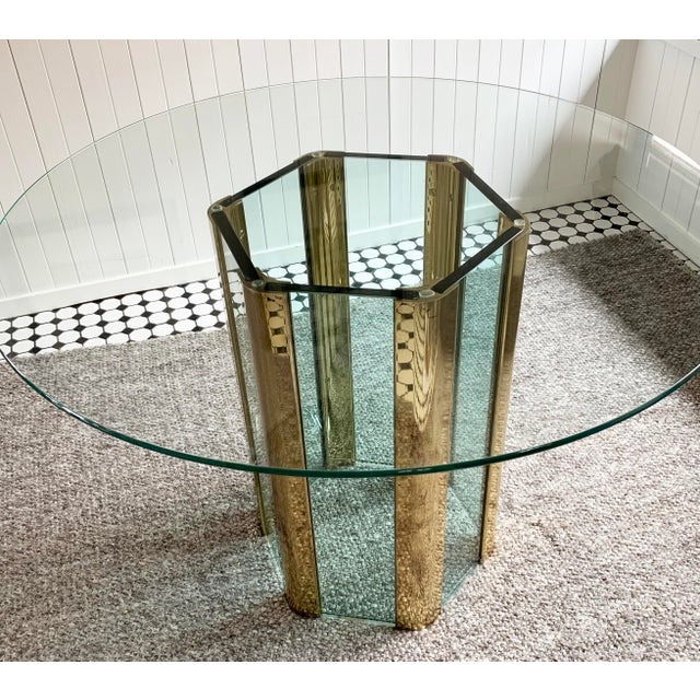 Leon Rosen for The Pace Collection designed this dining table in a rare hexagonal form. Brass and glass table base Table...