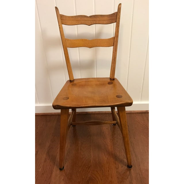 Great MCM Cushman chair. I think this is birch but could be maple. Solid wood and very sturdy with that classic Cushman...