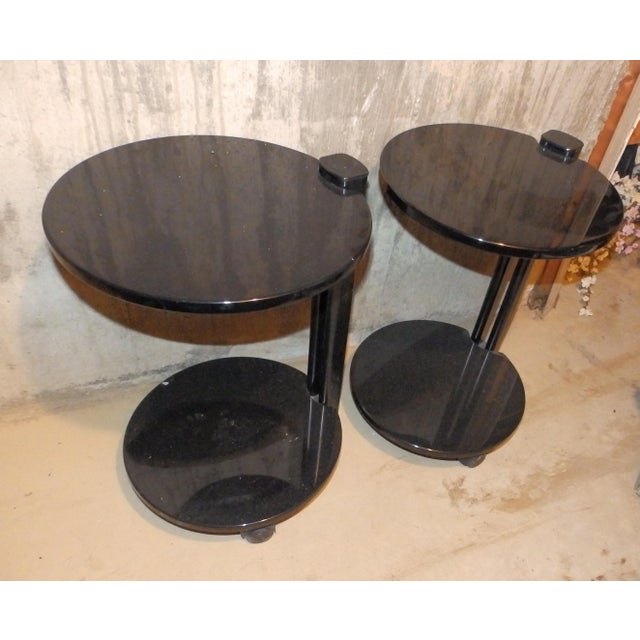 Beautiful set of black lacquered side tables on castors. Perfect for entertaining in a small space or where you want the...