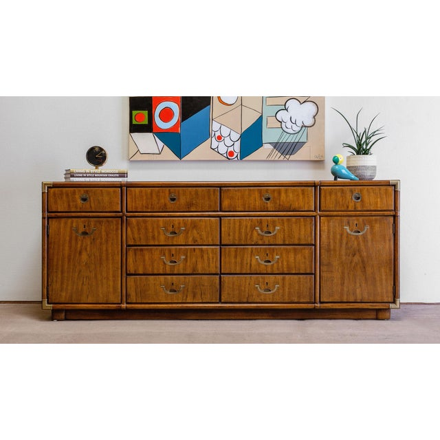 "Drexel campaign dresser for their ""Accolade"" collection. Features: • Beautiful, warm, rich walnut wood grain • Polished..."