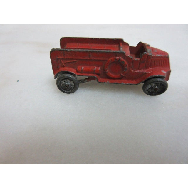 An antique firetruck toy. Great shape... as found original condition... Shows age related wear, chipped paint... no rust....