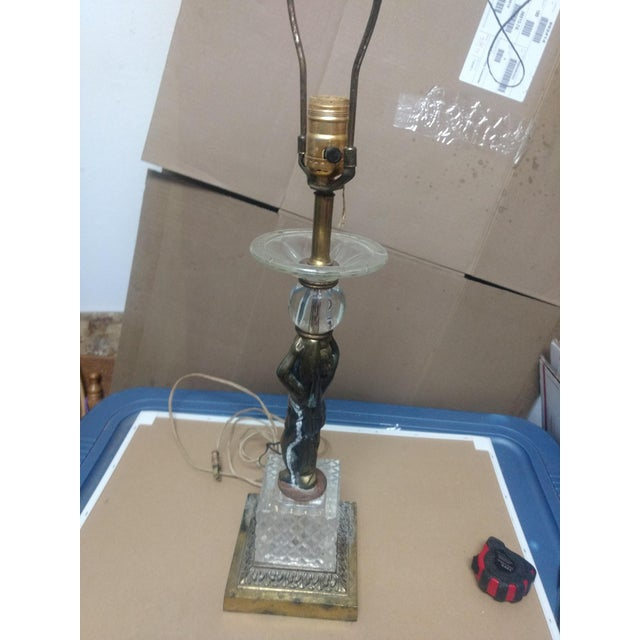 This unique lamp has several characteristics that anyone can appreciate. The beautiful Crystal blended in with the brass....