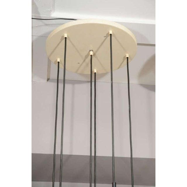 Industrial RAAK ceiling mount fixture.