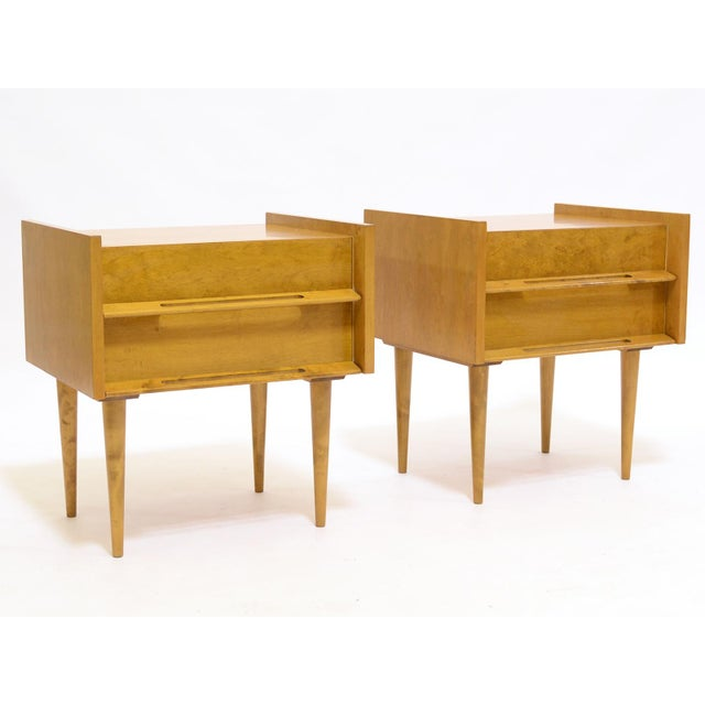 Light in color, light in scale, this handsome pair of nightstands by Edmond Spence are perched on long tapering legs ,...