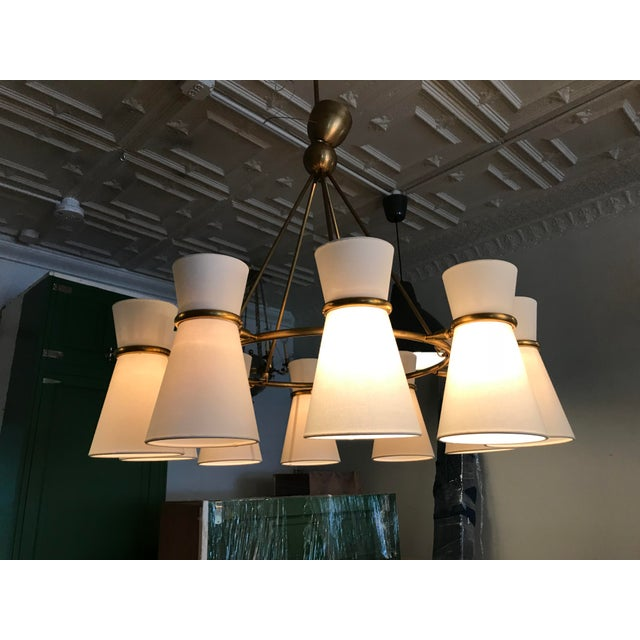 Clarkson chandelier by Aerin for Visual Comfort in antique brass. This is right on trend with cone shaped mid century...