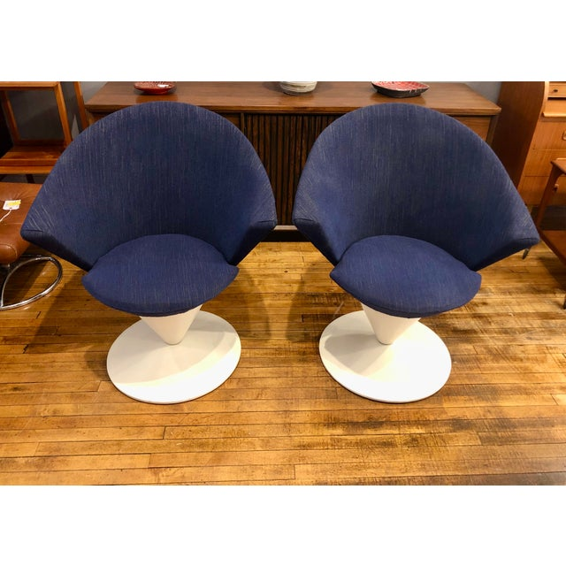 Outstanding pair of Swivel Cone chairs designed by Adrian Pearsall for Craft Associates, circa 1960's. The swivel base is...
