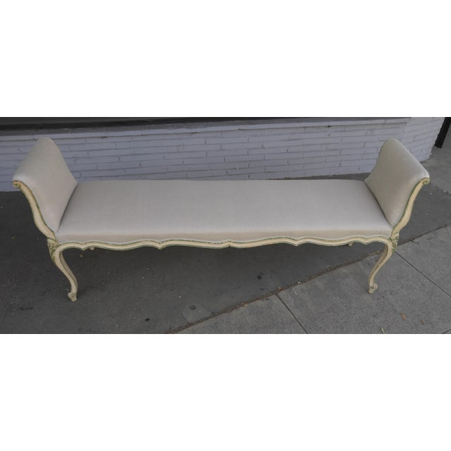 French bench with arms, in an Antiqued hand painted finish, upholstered in Rogers and Goffigon linen and Decor De Paris...