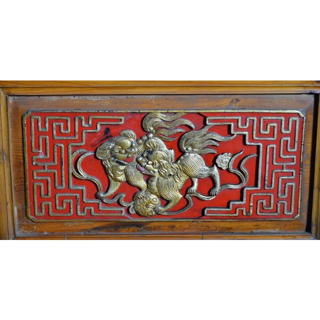19th Century Chinese Qing Dynasty Wooden Armoire With Hand-Carved Gilt Panels For Sale - Image 4 of 13