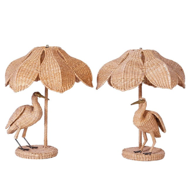Folky and fun pair of wicker or reed egret table lamps. These birds have a brass face and beak and your choice of wicker...