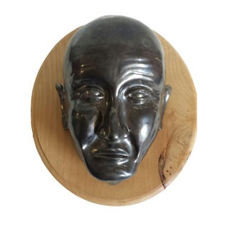 Pewter Clay Mask on Natural Wood Plaque Tribal For Sale