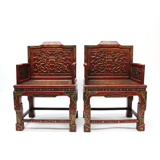 A beautiful vintage set of two hand-painted Tibetan chairs. These chairs are painted in the traditional the bright color...