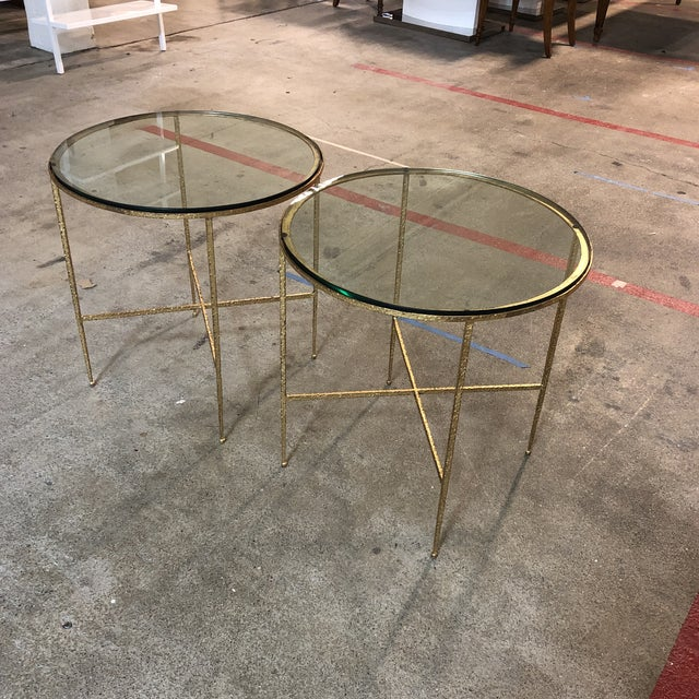 Design Plus Gallery presents a pair of custom side tables. Round framed beauties with textured steels details in a brass...