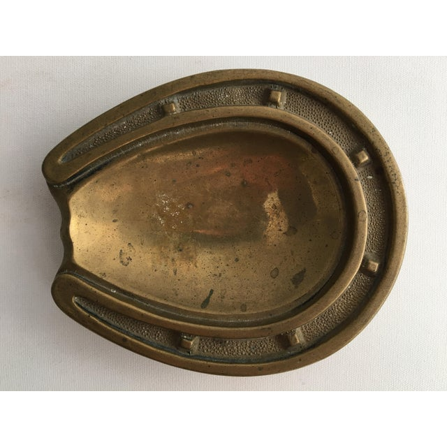1950s Italian Brass Horseshoe Ashtray. Some patina to finish, expected with age.