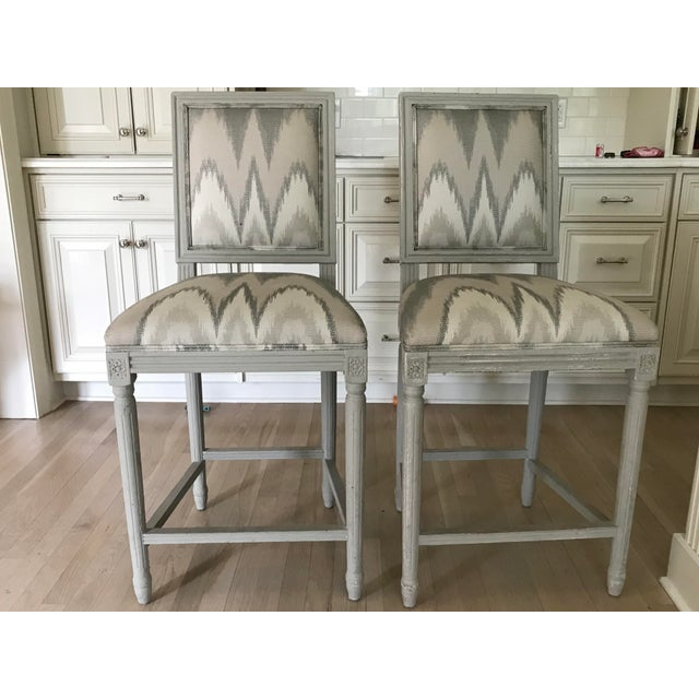 This is a pair of counter height bar stools that feature custom paint and distressing. Beautiful, classic and comfortable,...