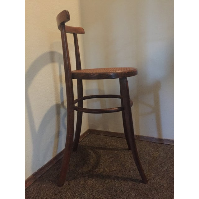 Beautiful antique bentwood chair with caned seat. We are in love with the intricately woven cane and the patina of the...