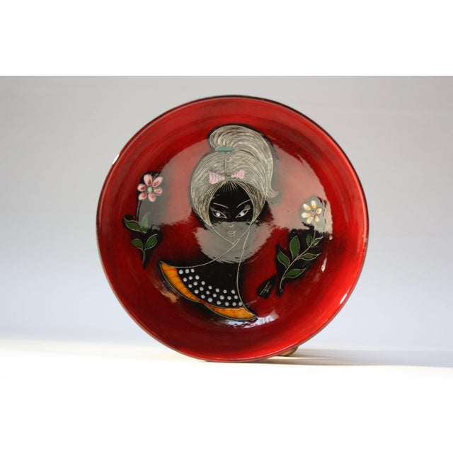 Circa 1960s Italian ceramic bowl in the San Marino style made by 'Professor Melior,' an accomplished ceramicist and...