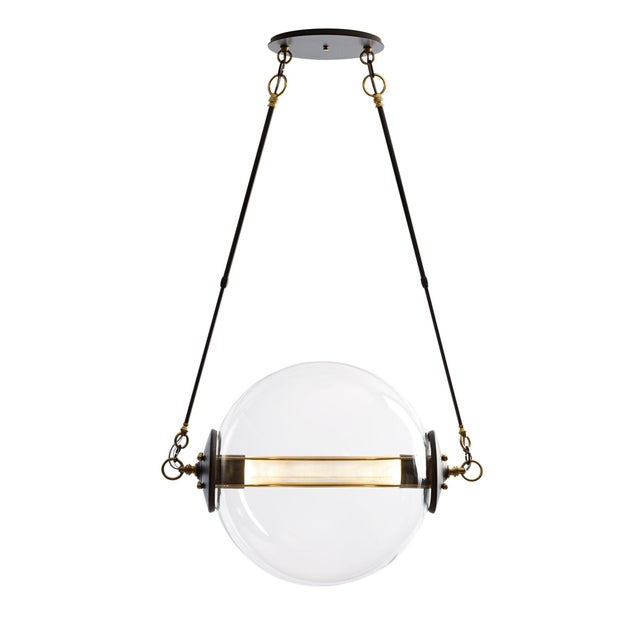 Beautiful pendant light, handcrafted by skilled artisans in Vermont. This pendant light features a large blown-glass...