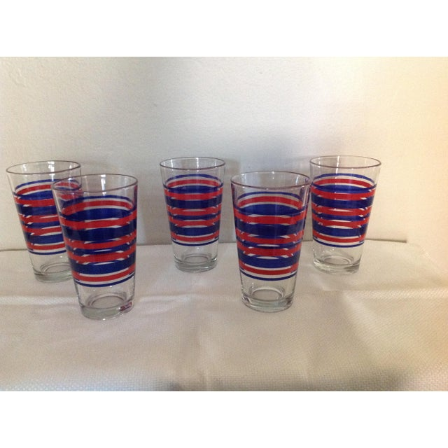 This set of five glasses are in really good condition. The red and blue stripes are bold.