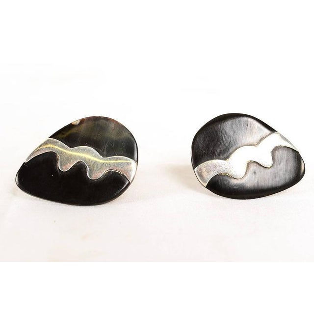 Beautiful pair of matching cufflinks made of freeform onyx and sterling silver. Stamped .925 sterling TAXCO, Initials CD....