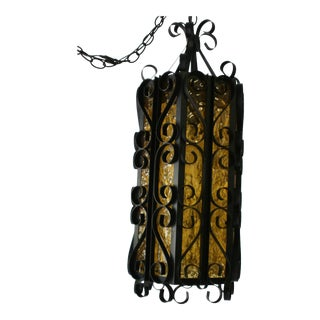 Mid-Century Mexican Black Wrought Iron & Amber Glass Swag Lamp For Sale