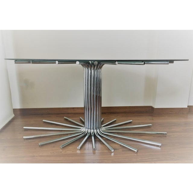 Spectacular mid-century chrome starburst dining table with smoked glass top. This table allows for a guaranteed match to...
