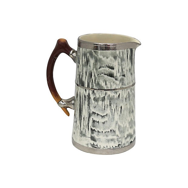 1930s Arthur Woods Silver Shield pitcher. Faux-bois pattern (false wood) faux-antler handle. Shields and accents are all...