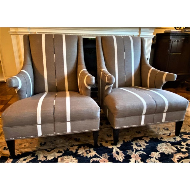 21st c., Custom made pair of armchairs, expertly upholstered in a suiting style striped wool fabric. Feature Hans Wegner...