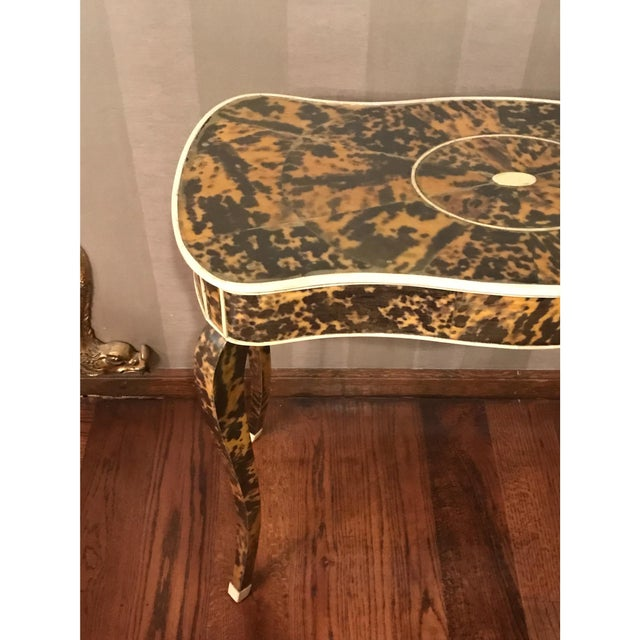 French tortoise and ivory occasional table. The piece dates back to the 1920s.