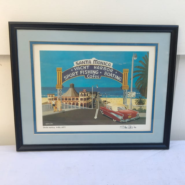 """A wonderful Southern California historical lifestyle piece called """" Santa Monica Pier 1957"""" by the artist Stan Cline who..."""