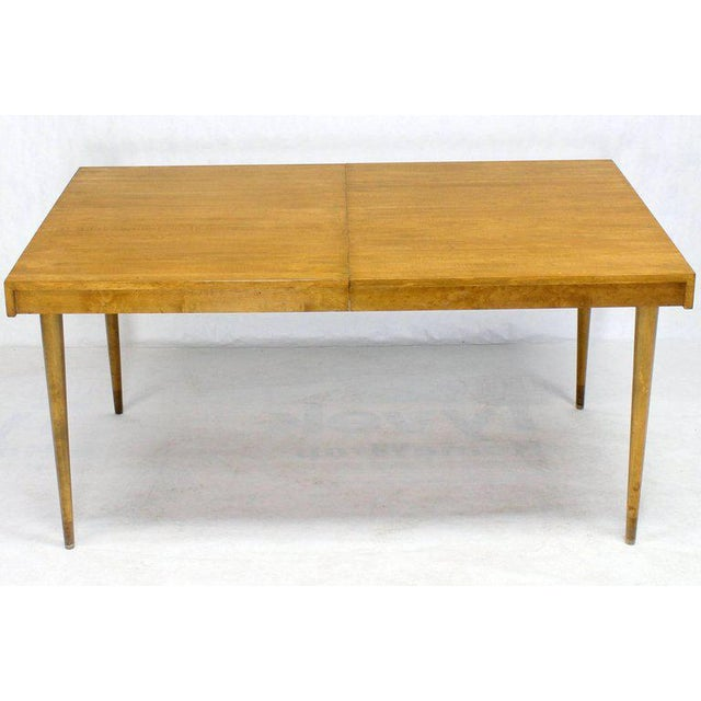 """Edmond J. Spence Mid century modern blond birch dining table with two 14"""" long leaves."""
