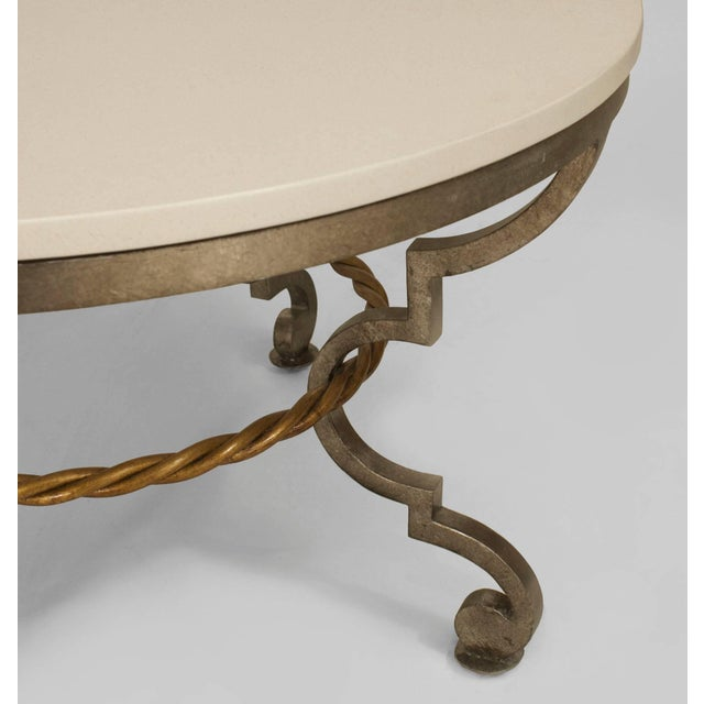 Art Modern style (Poillerat style) (Modern) silver patinated bronze round coffee table with a gilt rope design stretcher...