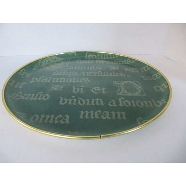 Round drinks tray with latin script and gold details. This vintage tray would look beautiful in any room for drinks,...