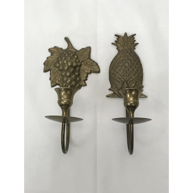 """Two candle sconces for wall mounting with glass votive holders with lots go natural patina. Grape motif: 7""""H x 3.5""""W x 3.25""""D"""