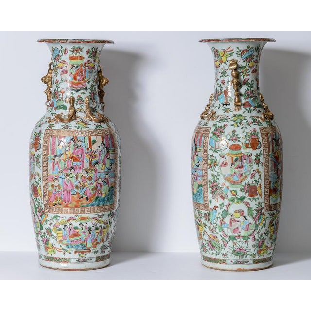 Lovely pair of large Rose Medallion vases with Greek Key cartouches of family scenes on the front and back of the vases....