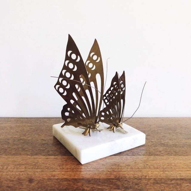 """Vintage 1960s pair of brass butterfly wall mounts. Large: 7.75"""" x 4"""" x 2.5"""" Small: 5"""" x 2.75"""" x 1.5"""""""