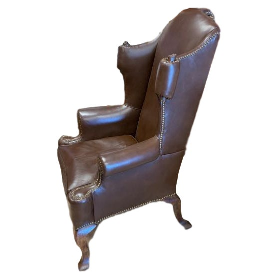 How did the upholsterer get the leather inside the curling scrolls on the sides and back of this wing back chair? This...