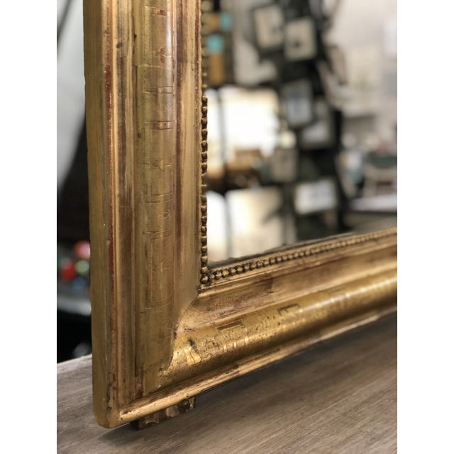 19th C. French Louis Philippe gilt mirror with rounded top corners and beaded trim; typical of this style and period....