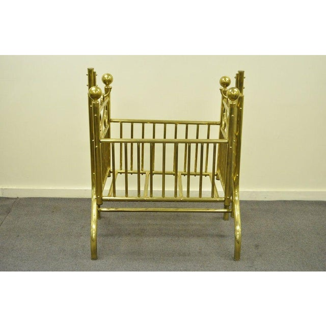 Item: Striking Vintage Solid Brass Infant's Suspended Rocking Cradle in the Victorian Style. The piece has a nice wide...