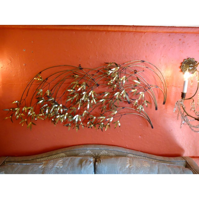This is a super cool, brass and metal mid century modern wall sculpture of abstract branches and leaves. Signed by Curtis...