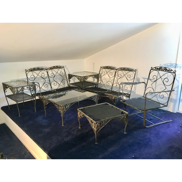 This vintage set of wrought iron patio set was handed down from multiple generations. The original cushions are gone , the...