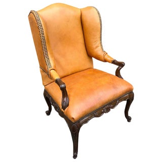 Louis XIV Style Carved Mahogany and Saddle Leather Armchair or Bergère For Sale