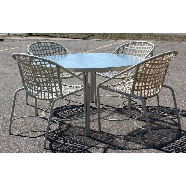 For your consideration is an outdoor patio dining set, including a table with a glass top and four chairs, by Brown Jordan...