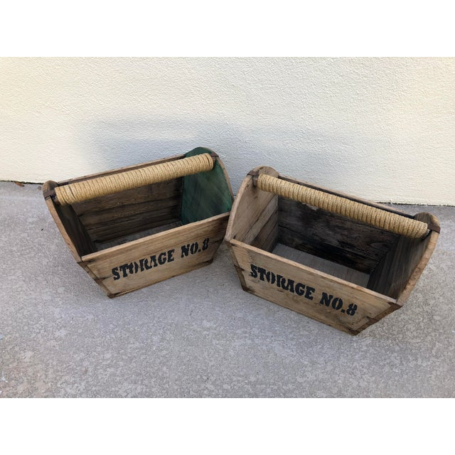 Vintage wooden storage containers accented with roped handles and later dated graphic elements. Great for floral kitchen...