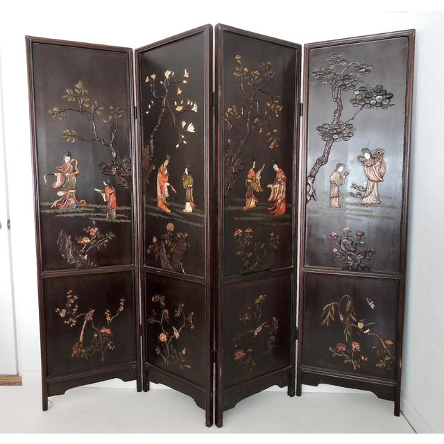 Take a minute to look at this beautiful early-mid 20th. century four panel Chinese black lacquer screen. The front...